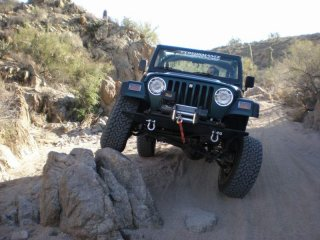 """One of the few pics I have of my first Jeep- '98 TJ,  Locked f&r 30/44, 5"""" lift, 33s, bumpers and winch."""