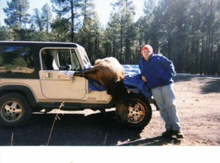 Posing with my uncles elk on the hood of his Jeep, this was the Jeep that hooked me.