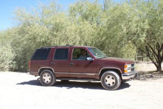 The other rig in the family. My dad in his '99 Tahoe, that thing has been more places than 90% of the Jeeps out there and the pinstripes, dents, chunked tires, dented skids, bent exhaust and bent running boards prove it.